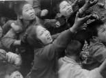 Out of a Train Window, ©Jay Moca: Korean children begging along side of troop train in Korea in 1955